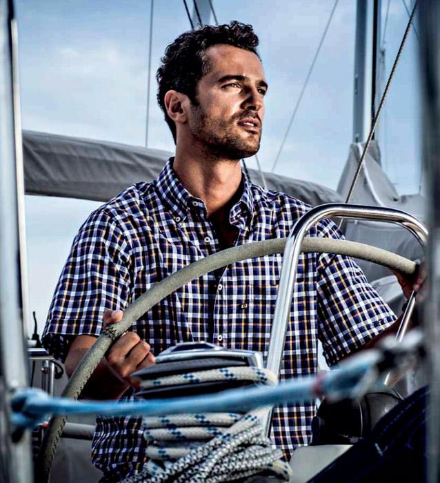 man-sailing-with-checked-shirt