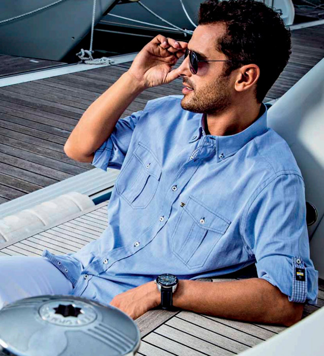man-wearing-sunglasses-and-light-blue-shirt