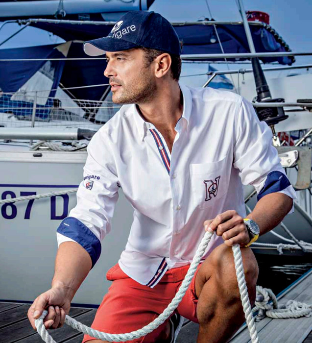 man-by-a-boat-with-white-shirt
