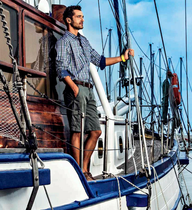man-on-a-boat-wearing-navigare-shirt