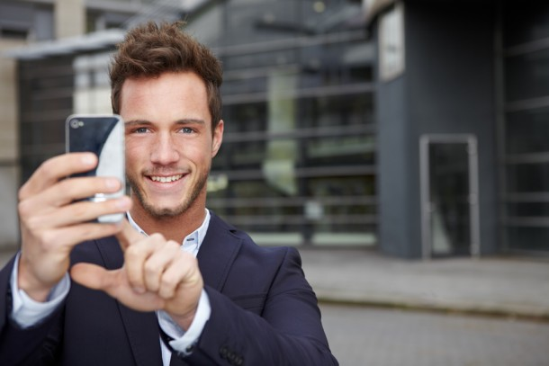 Man takes picture with smartphone